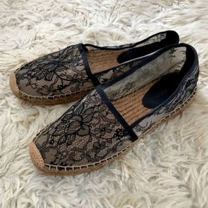 Dolce and Gabbana black lace espadrilles.